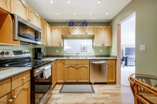 """Photo 3: 201 19241 FORD Road in Pitt Meadows: Central Meadows Condo for sale in """"Village Greem"""" : MLS®# R2617880"""