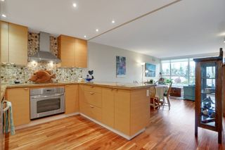 """Photo 3: 209 1490 PENNYFARTHING Drive in Vancouver: False Creek Condo for sale in """"Harbour Cove 3"""" (Vancouver West)  : MLS®# R2560559"""