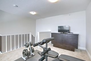 Photo 29: 2407 15 SUNSET Square: Cochrane Apartment for sale : MLS®# A1072593