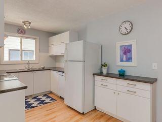 Photo 6: 20 FALCONRIDGE Place NE in Calgary: Falconridge Semi Detached for sale : MLS®# C4302854