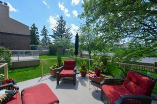 Photo 3: 18 1220 Prominence Way SW in Calgary: Patterson Row/Townhouse for sale : MLS®# A1133893
