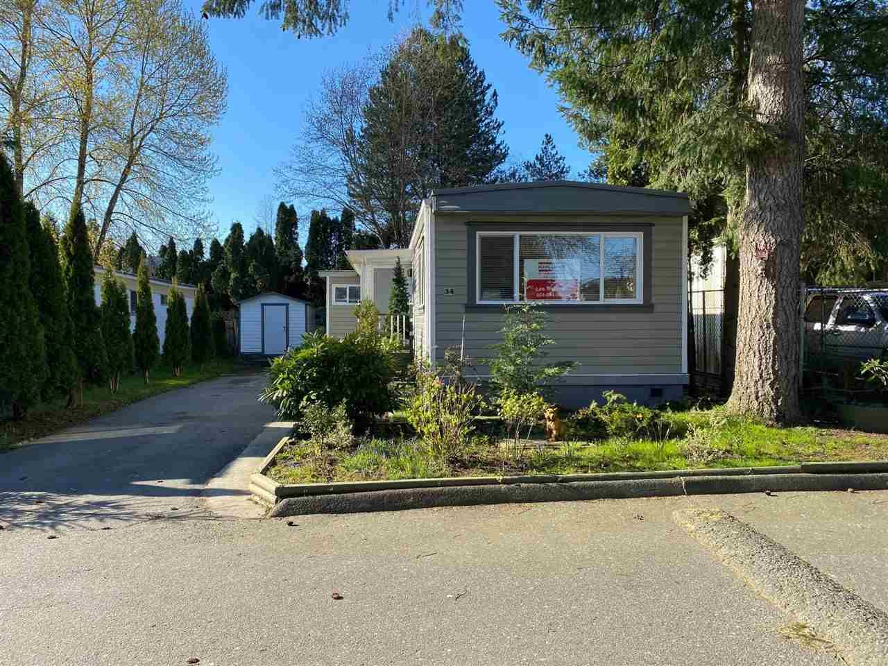 "Main Photo: 34 13650 80 Avenue in Surrey: Bear Creek Green Timbers Manufactured Home for sale in ""Leeside"" : MLS®# R2565699"