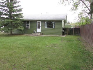 """Photo 2: 12781 OLD HOPE Road: Charlie Lake House for sale in """"CHARLIE LAKE"""" (Fort St. John (Zone 60))  : MLS®# R2043655"""