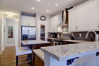 Photo 7: 62 AUBURN GLEN Manor SE in Calgary: Auburn Bay Detached for sale : MLS®# C4191835
