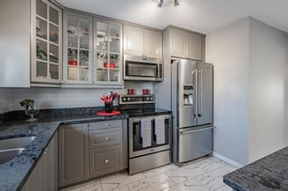 Photo 11: 14 7166 18 Street SE in Calgary: Ogden Row/Townhouse for sale : MLS®# A1091974