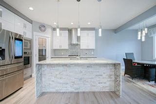 Photo 10: 48 Tremblant Terrace SW in Calgary: Springbank Hill Detached for sale : MLS®# A1131887