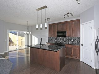 Photo 7: 142 SAGE BANK Grove NW in Calgary: Sage Hill House for sale : MLS®# C4149523