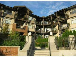 "Photo 1: 311 400 KLAHANIE Drive in Port Moody: Port Moody Centre Condo for sale in ""TIDES"" : MLS®# V870008"
