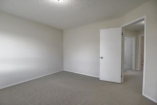 Photo 19: 25 Tuscany Springs Gardens NW in Calgary: Tuscany Row/Townhouse for sale : MLS®# A1053153