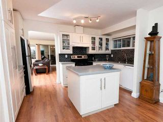 """Photo 1: 22 795 NOONS CREEK Drive in Port Moody: North Shore Pt Moody Townhouse for sale in """"HERITAGE TERRACE"""" : MLS®# V981692"""