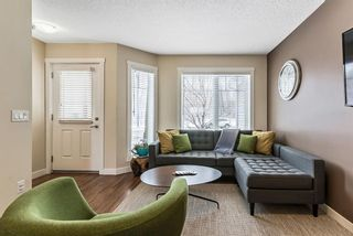 Photo 4: 1562 93 Street SW in Calgary: Aspen Woods Row/Townhouse for sale : MLS®# A1085332