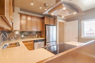 Photo 4: 37 CADOGAN Road NW in Calgary: Cambrian Heights Detached for sale : MLS®# C4294170