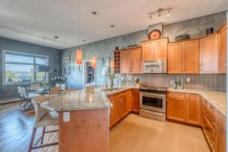 Photo 7: 408 35 Aspenmont Heights SW in Calgary: Aspen Woods Apartment for sale : MLS®# A1149292
