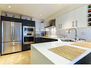 "Photo 1: 309 1230 QUAYSIDE Drive in New Westminster: Quay Condo for sale in ""TIFFANY SHORES"" : MLS®# V1118946"