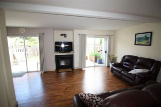 """Photo 1: 11 5630 TRAIL Avenue in Sechelt: Sechelt District Townhouse for sale in """"HIGHPOINT"""" (Sunshine Coast)  : MLS®# R2472370"""