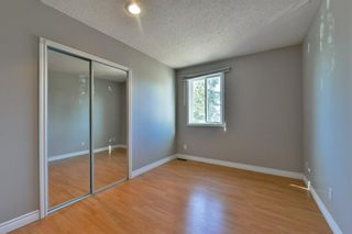 Photo 18: 1301 829 Coach Bluff Crescent in Calgary: Coach Hill Row/Townhouse for sale : MLS®# A1094909
