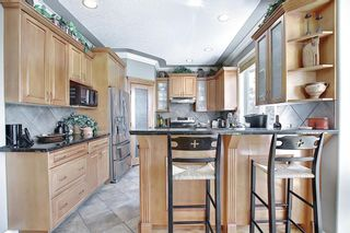 Photo 12: 17 Simcrest Manor SW in Calgary: Signal Hill Detached for sale : MLS®# A1128718