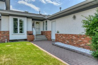 Photo 5: 20A Woodmeadow Close SW in Calgary: Woodlands Row/Townhouse for sale : MLS®# A1127050
