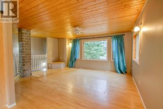 Photo 3: 5353 QUA PLACE in 108 Mile Ranch: House for sale : MLS®# R2602919