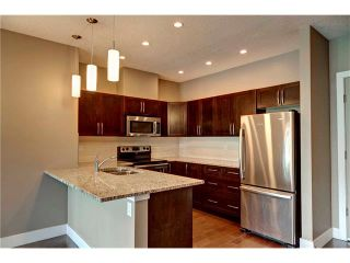 Photo 4: 315 1899 45 Street NW in Calgary: Montgomery Condo for sale : MLS®# C4115653