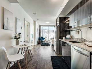 Photo 2: 801 450 8 Avenue SE in Calgary: Downtown East Village Apartment for sale : MLS®# A1071228
