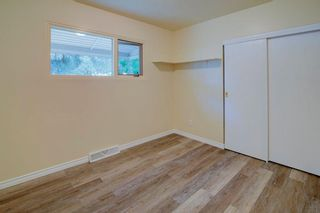 Photo 13: 50 FRASER Road SE in Calgary: Fairview Detached for sale : MLS®# A1145619