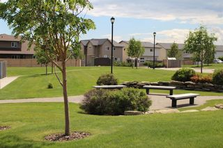 Photo 2: 1404 Clover Link: Carstairs Row/Townhouse for sale : MLS®# A1073804
