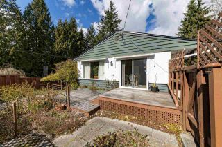 Photo 1: 1428 PAISLEY Road in North Vancouver: Capilano NV House for sale : MLS®# R2555008