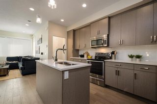 Photo 4: 2 1920 25A Street SW in Calgary: Richmond Row/Townhouse for sale : MLS®# A1102890