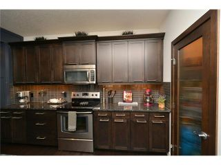 Photo 11: 12 SAGE MEADOWS Circle NW in Calgary: Sage Hill House for sale : MLS®# C4053039