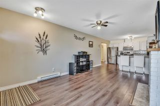 """Photo 4: 10 18960 ADVENT Road in Pitt Meadows: Central Meadows Townhouse for sale in """"MEADOWLAND VILLAGE"""" : MLS®# R2545154"""