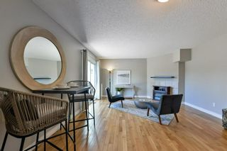Photo 8: 1301 829 Coach Bluff Crescent in Calgary: Coach Hill Row/Townhouse for sale : MLS®# A1094909