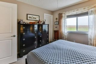 Photo 18: 303 300 Clover Way: Carstairs Row/Townhouse for sale : MLS®# A1145046