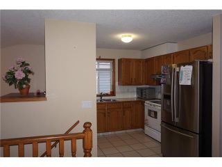 Photo 8: 260 ERIN MEADOW Close SE in Calgary: Erin Woods House for sale : MLS®# C4095343