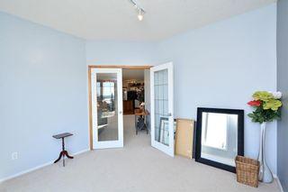 Photo 28: 303 GLENEAGLES View: Cochrane House for sale : MLS®# C4130061