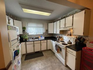 Photo 4: 10 1706 22 Avenue: Didsbury Row/Townhouse for sale : MLS®# A1110698