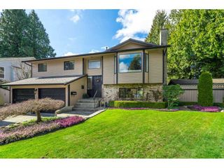 """Photo 1: 6155 131 Street in Surrey: Panorama Ridge House for sale in """"PANORAMA PARK"""" : MLS®# R2556779"""