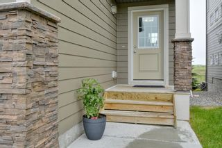 Photo 3: 643 101 Sunset Drive N: Cochrane Row/Townhouse for sale : MLS®# A1117436