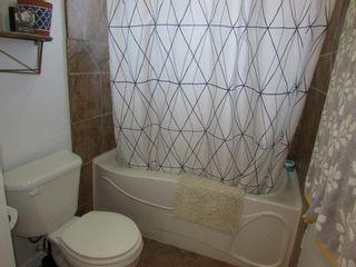 Photo 21: 209 9 Avenue NE: Sundre Detached for sale : MLS®# A1120415
