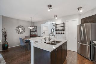 Photo 12: 31 Tuscany Springs Way NW in Calgary: Tuscany Detached for sale : MLS®# A1041424