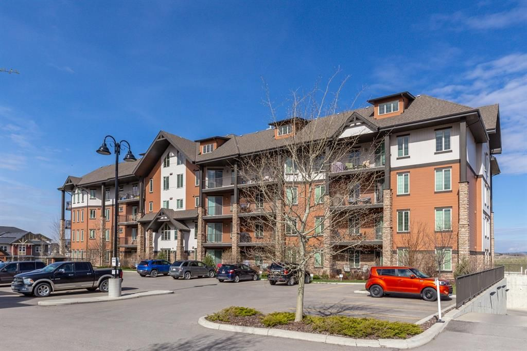 Main Photo: 2407 15 SUNSET Square: Cochrane Apartment for sale : MLS®# A1072593