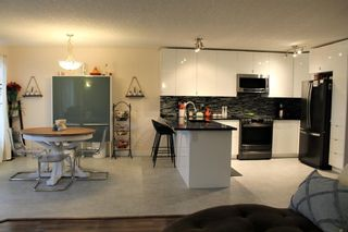 Photo 7: 201 Valarosa Place: Didsbury Detached for sale : MLS®# A1085244