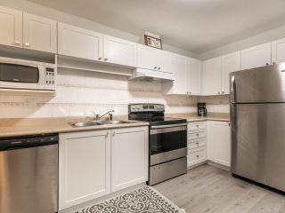 """Photo 6: 112 8068 120A Street in Surrey: Queen Mary Park Surrey Condo for sale in """"Melrose Place"""" : MLS®# R2552952"""