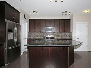 Photo 4: 76 PANORA View NW in Calgary: Panorama Hills House for sale : MLS®# C4145331