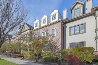 Main Photo: 195 Ypres Green SW in Calgary: Garrison Woods Row/Townhouse for sale : MLS®# A1155387