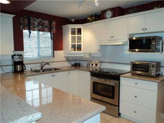 "Photo 5: 75 2979 PANORAMA Drive in Coquitlam: Westwood Plateau Townhouse for sale in ""DEERCREST"" : MLS®# V935117"