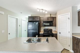 Photo 4: 9103 2781 Chinook Winds Drive SW: Airdrie Row/Townhouse for sale : MLS®# A1102621