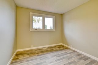 Photo 25: 215 Strathearn Crescent SW in Calgary: Strathcona Park Detached for sale : MLS®# A1146284