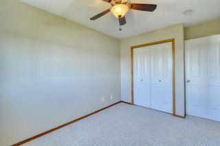 Photo 34: 12 West Hall Place: Cochrane Detached for sale : MLS®# A1119224
