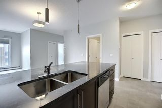 Photo 6: 2419 604 East Lake Boulevard NE: Airdrie Apartment for sale : MLS®# A1072168